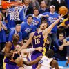 Photo -  NBA PLAYOFFS / L.A. LAKERS: L.A.'s Pau Gasol (16) tries to rebound the ball over NIck Collison (4), second from left, and Serge Ibaka (9), right, of Oklahoma City along with teammates Lamar Odom (7), left, and Derek Fisher (2) late in the fourth quarter during the NBA basketball game between the Los Angeles Lakers and the Oklahoma City Thunder in game six of the first round series at the Ford Center in Oklahoma City, Friday, April 30, 2010. L.A. beat Oklahoma City 95-94, winning the series 4-2. Photo by Nate Billings, The Oklahoman ORG XMIT: KOD