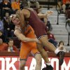 Photo - OU's Keldrick Hall wrestles OSU's Alan Gelogaev during the wrestling match between Oklahoma University and Oklahoma State University at McCasland Field House in Norman, Okla.,Sunday, Dec. 9, 2012.  Photo by Garett Fisbeck, For The Oklahoman