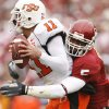 Oklahoma\'s Nic Harris (5) sacks Oklahoma State quarterback Zac Robinson (11) during the first half of the college football game between the University of Oklahoma Sooners (OU) and the Oklahoma State University Cowboys (OSU) at the Gaylord Family-Memorial Stadium on Saturday, Nov. 24, 2007, in Norman, Okla. Photo By Bryan Terry, The Oklahoman
