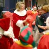 Mrs. Claus offers an Elmo to an Earl…Earl Halbritter a young patient at the J. D. McCarty Center in Norman... during the Oklahoma Municipal Contractor's Association annual Christmas party for the rehab hospital's inpatients. Holding Halbritter is Natalie Bell, McCarty Center direct care specialist. Portraying Mr. and Mrs. Santa Claus are OMCA members Don Manning and Vicki Moore. Community Photo By: Greg Gaston Submitted By: Greg, Norman