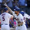 Photo - New York Mets' Daniel Murphy, center, celebrates after hitting a two-run home run during the ninth inning of a baseball game against the Philadelphia Phillies, Sunday, May 11, 2014, in New York. (AP Photo/Jason DeCrow)