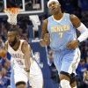 Oklahoma City\'s James Harden celebrates a three-pointer he scored over Denver\'s Al Harrington (right) during the first round NBA Playoff basketball game between the Thunder and the Nuggets at OKC Arena in downtown Oklahoma City on Wednesday, April 20, 2011. Photo by John Clanton, The Oklahoman