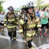 A group of three fireman walk away from the starting line of the 14th Annual Oklahoma City Memorial Marathon in Oklahoma City, Sunday, April 27, 2014. The marathon was delayed over two hours beyond it\'s original start time of 6 a.m. Photo by KT King/The Oklahoman