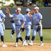 Photo - FILE - In this April 21, 2013 file photo, North Carolina players celebrate their 10-1 win over Duke in an NCAA college baseball game in Chapel Hill, N.C.  If there's a blueprint to survive in this new college baseball world of pitching and defense, it looks like the Tar Heels and Tigers have found it. (AP Photo/Karl B DeBlaker, File)