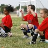 L-R: Maya Qureshi, 6, Brycen Jones, 7, and Peyton Wilson, 6, cheer for their teammates during the Edmond Soccer Club\'s camp for boys and girls in Edmond, OK, Monday, July 20, 2009. By Paul Hellstern, The Oklahoman
