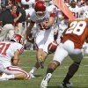 Oklahoma\'s Michael Hunnicutt (18) kicks a field goal during the Red River Rivalry college football game between the University of Oklahoma Sooners (OU) and the University of Texas Longhorns (UT) at the Cotton Bowl in Dallas, Saturday, Oct. 8, 2011. Photo by Chris Landsberger, The Oklahoman