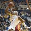 West Virginia\'s Juwan Staten (3) drives to the basket during the second half of an NCAA college basketball game against Iowa State, Monday, Feb. 10, 2014, in Morgantown, W.Va. West Virginia won 102-77. (AP Photo/Andrew Ferguson)