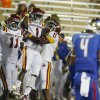 Photo - Iowa State's Jarvis West celebrates a touchdown with EJ Bibbs and Tad Ecby during the first half of an NCAA college football game, Thursday, Sept. 26, 2013 in Tulsa, Okla. (AP Photo/Tulsa World, Tom Gilbert)  ONLINE OUT; TV OUT; TULSA OUT