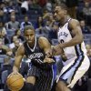 Orlando Magic\'s Moe Harkless (21) moves the ball past Memphis Grizzlies\' Darrell Arthur during the first half of an NBA basketball game in Memphis, Tenn., Friday, Feb. 22, 2013. (AP Photo/Danny Johnston)