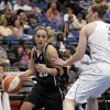 Photo - San Antonio Silver Stars guard Becky Hammon, left, drives around Minnesota Lynx forward Nicole Ohlde during the second half of a basketball game Sunday, June 8, 2008 in Minneapolis. Hammon had 14 points on the night as the Lynx won 90-78. (AP Photo/Paul Battaglia) ORG XMIT: MNPB106