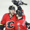 Photo - Calgary Flames' Dennis Wideman, right, celebrates his goal with teammate TJ Galiardi during second period of an NHL hockey game in Calgary, Alberta, Saturday, Feb. 1, 2014. (AP Photo/The Canadian Press, Jeff McIntosh)