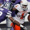 Oklahoma State\'s Joseph Randle (1) looks for running room past Kansas State\'s Emmanuel Lamur (23) during the first half of the college football game between the Oklahoma State University Cowboys (OSU) and the Kansas State University Wildcats (KSU) on Saturday, Oct. 30, 2010, in Manhattan, Kan. Photo by Chris Landsberger, The Oklahoman