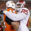 Oklahoma\'s Ryan Broyles (85) hugs Oklahoma State\'s Grant Goodwin (44) after the Sooners 47-41 win during the Bedlam college football game between the University of Oklahoma Sooners (OU) and the Oklahoma State University Cowboys (OSU) at Boone Pickens Stadium in Stillwater, Okla., Saturday, Nov. 27, 2010. Photo by Chris Landsberger, The Oklahoman
