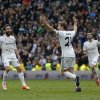 Photo - Real Madrid's Asier Illarramendi, centre, celebrates his goal with teammates during a Spanish La Liga soccer match between Real Madrid and Elche at the Santiago Bernabeu stadium in Madrid, Spain, Saturday, Feb. 22, 2014. (AP Photo/Andres Kudacki)