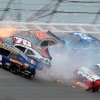 Photo - Brian Scott (2) crashes with Johanna Long (70), Trevor Bayne (6), Ty Dilon (33) and Sam Hornish Jr. (12) in Turn 3 during the NASCAR Nationwide Series auto race at the Talladega Superspeedway in Talladega, Ala., Saturday, May 4, 2013. (AP Photo/Dale Davis)
