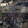 Egyptian army tanks secure the perimeter of the presidential palace while protesters gather chanting anti president Mohammed Morsi slogans, in Cairo, Egypt, Friday, Dec. 7, 2012. Thousands of Egyptians took to the streets after Friday midday prayers in rival rallies and marches across Cairo, as the standoff deepened over what opponents call the Islamist president\'s power grab, raising the specter of more violence. (AP Photo/Nasser Nasser)