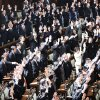 Photo -   Prime Minister Yoshihiko Noda, second row from top, third left, stands still while other lawmakers shout banzai, or long live, after he dissolved the lower house of parliament in Tokyo Friday, Nov. 16, 2012. Noda dissolved the lower house of parliament Friday, paving the way for elections in which his ruling party will likely give way to a weak coalition government divided over how to solve Japan's myriad problems. (AP Photo/Koji Sasahara)