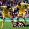 Photo - Sunderland's Phil Bardsley, center, vies for the ball with Crystal Palace's Glenn Murray, right, and Joe Ledley, during their English Premier League soccer match at the Stadium of Light, Sunderland, England, Saturday, March 15, 2014. (AP Photo/Scott Heppell)