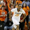 Oklahoma State\'s Kamari Murphy (21) celebrates during an NCAA college basketball game between the Oklahoma State Cowboys (OSU) and the University of Texas Longhorns at Gallagher-Iba Arena in Stillwater, Okla., Wednesday, Jan. 8, 2014. Oklahoma State won 87-74. Photo by Bryan Terry, The Oklahoman
