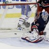 New York Rangers goalie Henrik Lundqvist, of Sweden, deflects a shot on the goal during the first period of an NHL hockey game against the Montreal Canadiens, Tuesday, Feb. 19, 2013, in New York. (AP Photo/Frank Franklin II)