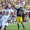 Photo - Michigan quarterback Devin Gardner (12) throws a touchdown pass into coverage in the second quarter of an NCAA college football game against Central Michigan, Saturday, Aug. 31, 2013, in Ann Arbor, Mich. (AP Photo/Tony Ding)