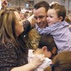 Sgt. Thomas Leach gets hugs from his wife Holly and boys Tommy, 10, and Noah, 2, as soldiers from the 45th return from a year\'s deployment in Afghanistan to waiting family members in Oklahoma City, OK, Saturday, March 3, 2012. By Paul Hellstern, The Oklahoman