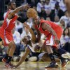 Los Angeles Clippers\' Chris Paul, left, grabs a loose ball next to Golden State Warriors\' Carl Landry, bottom center, and teammate Lamar Odom, right, during the first half of an NBA basketball game in Oakland, Calif., Wednesday, Jan. 2, 2013. (AP Photo/Marcio Jose Sanchez)