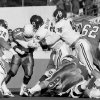 OU defense of Frank Blevins (35), Kert Kaspar (46) and Scott Evans (78) stops OSU\'s Barry Sanders (21) during the University of Oklahoma (OU) at Oklahoma State University (OSU) Bedlam college football in Stillwater, Nov. 5, 1988. PHOTO BY JIM ARGO THE OKLAHOMAN