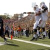 Oklahoma State\'s Joseph Randle (1) and Nick Martinez (75) celebrate a touchdown during a college football game between the Oklahoma State University Cowboys (OSU) and the University of Missouri Tigers (Mizzou) at Faurot Field in Columbia, Mo., Saturday, Oct. 22, 2011. Photo by Sarah Phipps, The Oklahoman