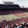 A sell-out crowd of more than 75,000 fans watches the half-time performances on Owen Field at the Nov. 24, 1984 college football game between the University of Oklahoma Sooners and the Oklahoma State Cowboys. OU beat OSU this particular Saturday, 24-14, and OU went on to post a 9-2-1 that season. Staff photo by Jim Argo