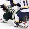 Minnesota Wild goalie Niklas Backstrom (32), of Finland, makes the save as Nashville Predators left wing Martin Erat (10), of Czech Republic, trips over him during the first period of an NHL hockey game Saturday, Feb. 9, 2013 in St. Paul, Minn. (AP Photo/Genevieve Ross)