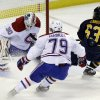 Buffalo Sabres\' Tyler Ennis (63) scores on Montreal Canadiens goalie Peter Budaj, of Slovakia, as Canadiens\' Andrei Markov (79), of Russia, defends during the second period of an NHL hockey game in Buffalo, N.Y., Thursday, Feb. 7, 2013. (AP Photo/David Duprey)