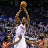 Oklahoma City\'s Kevin Durant (35) passes away from Houston\'s Patrick Beverley (12) and James Harden (13) during Game 2 in the first round of the NBA playoffs between the Oklahoma City Thunder and the Houston Rockets at Chesapeake Energy Arena in Oklahoma City, Wednesday, April 24, 2013. Oklahoma City won, 105-102. Photo by Nate Billings, The Oklahoman