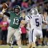 Norman North\'s Peyton Gavras (13) passes under pressure from Edmond North\'s Sam Brown (5) during a high school football game between Edmond North and Norman North in Norman, Okla., Thursday, Oct. 11, 2012. Photo by Nate Billings, The Oklahoman