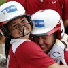 Lauren Chamberlain, left, hugs Shelby Pendley after Pendley\'s home run in the NCAA Super Regional softball game as the University of Oklahoma (OU) Sooners defeat Texas A&M 8-0 at Marita Hines Field on Saturday, May 25, 2013 in Norman, Okla. to advance to the College World Series. Photo by Steve Sisney, The Oklahoman