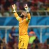 Photo - United States' goalkeeper Tim Howard celebrates after United States' Jermaine Jones scored a goal during the group G World Cup soccer match between the USA and Portugal at the Arena da Amazonia in Manaus, Brazil, Sunday, June 22, 2014. (AP Photo/Paulo Duarte)