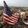 An American flag flies over debris in a residential area just west of Telephone Road in Moore Okla., after a tornado moved through the area on Monday, May 20, 2013. Photo by Bryan Terry, The Oklahoman