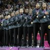 Members of USA\'s men\'s basketball team listen to the national anthem after winning the gold medal at the 2012 Summer Olympics, Sunday, Aug. 12, 2012, in London. (AP Photo/Eric Gay)