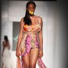 Photo -   A model shows a creation by designer Eki Orleans during the MTN Fashion and Design Week in Lagos, Nigeria, Friday, Oct. 26, 2012. (AP Photo/Sunday Alamba)