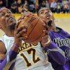 Los Angeles Lakers center Dwight Howard, left, puts up a shot as Sacramento Kings forward Jason Thompson defends during the second half of their NBA basketball game, Sunday, Nov. 11, 2012, in Los Angeles. The Lakers won 103-90. Howard had 23 points and 18 rebounds. (AP Photo/Mark J. Terrill)