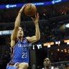 Oklahoma City\'s Kevin Martin (23) over to the hoop in front of Memphis\' Quincy Pondexter (20) during Game 3 in the second round of the NBA basketball playoffs between the Oklahoma City Thunder and Memphis Grizzles at the FedExForum in Memphis, Tenn., Saturday, May 11, 2013. Photo by Nate Billings, The Oklahoman