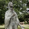 Photo - St. Kateri Tekakwitha, the Roman Catholic Church's first American Indian saint, is commemorated with a statue on the grounds of St. Gregory's Abbey in Shawnee.  PAUL HELLSTERN - Oklahoman