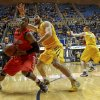 Radford\'s Javonte Green (2) is defended by West Virginia\'s Deniz Kilicli (13) during the first half of an NCAA college basketball game at WVU Coliseum in Morgantown, W.Va., on Saturday, Dec. 22, 2012. (AP Photo/David Smith)