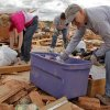 Bonnie Tschetter and Steve Lessman help recover items from the home of Jesse and Miranda Lewis that was destroyed by Tuesday\'s tornado west of El Reno, Wednesday, May 25, 2011. Photo by Chris Landsberger, The Oklahoman