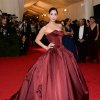 """Sarah Silverman attends The Metropolitan Museum of Art\'s Costume Institute benefit gala celebrating """"Charles James: Beyond Fashion"""" on Monday, May 5, 2014, in New York. (Photo by Evan Agostini/Invision/AP)"""