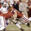 Kansas City, Mo. Saturday,12/06/2003 . BIG 12 CHAMPIONSHIP UNIVERSITY OF OKLAHOMA (OU) VS KANSAS STATE (KSU) COLLEGE FOOTBALL AT ARROWHEAD STADIUM. Sooners #8 Donte Nicholson & #94 Dusty Dvoracek hit Wildcats Ell Roberson to force a fumble late in the game. (Staff photo by Steve Gooch)