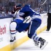 Photo - Toronto Maple Leafs defenseman Jake Gardiner, right, takes out Montreal Canadiens forward Brendan Gallagher, left, during the third period of an NHL hockey game in Toronto on Saturday, March 22, 2014. (AP Photo/The Canadian Press, Nathan Denette)