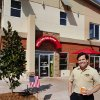 Schlotzsky\'s franchisee David Jones outside his new Midwest City location. His property includes upscale apartments above the eatery, part of Midwest City\'s