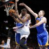 Oklahoma City\'s Kevin Durant goes past Golden State\'s David Lee during an NBA basketball game between the Oklahoma City Thunder and the Golden State Warriors at Chesapeake Energy Arena in Oklahoma City, Friday, Jan. 17, 2014. Photo by Bryan Terry, The Oklahoman