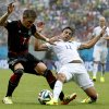 Germany\'s Bastian Schweinsteiger, left, is challenged by United States\' Alejandro Bedoya, right, during the group G World Cup soccer match between the USA and Germany at the Arena Pernambuco in Recife, Brazil, Thursday, June 26, 2014. (AP Photo/Matthias Schrader)